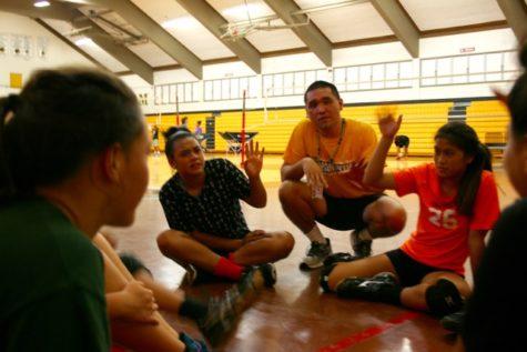 Jeff Uyemura-Reyes, NHIS JV Girl's Volleyball coach works with his team.