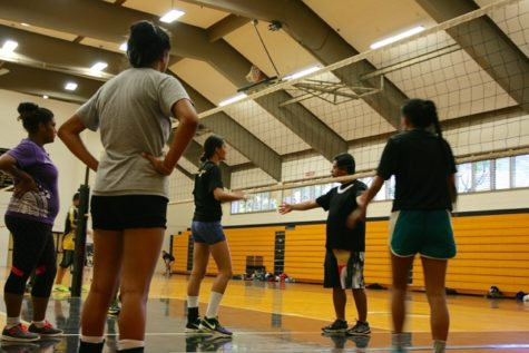 Jubei Wong, NHIS Varsity Volleyball coach, gives his players instructions.