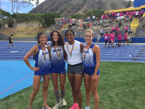 Kili Kawaiaea (in white) poses with three of the other race medalists from Dana Hills HS in California.