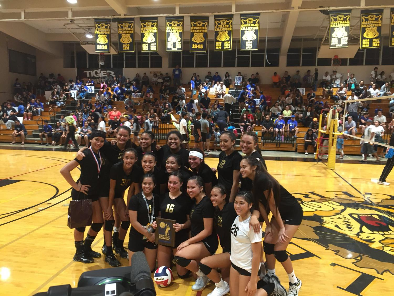 The Varsity Girl's Volleyball team pose after winning the championship.