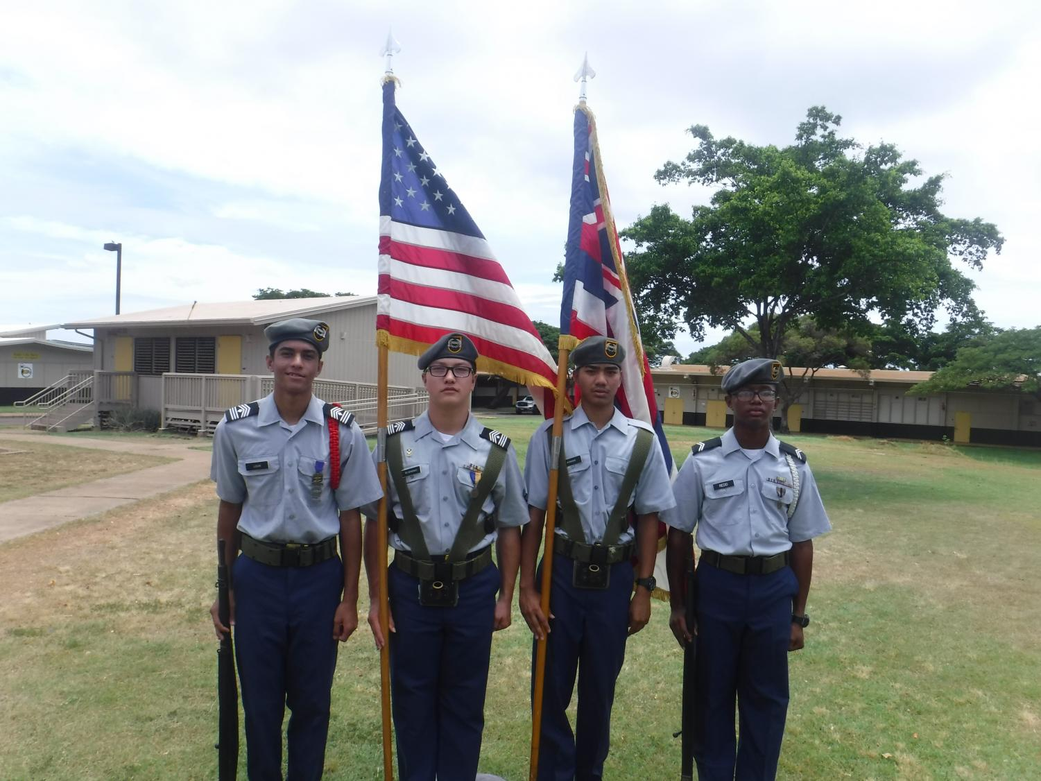 The NHIS JROTC Color Guard, comprised of students Djay Louis, Kainalu Glushenko, Andrew Koniske, and Devaughn Redd (pictured left to right).