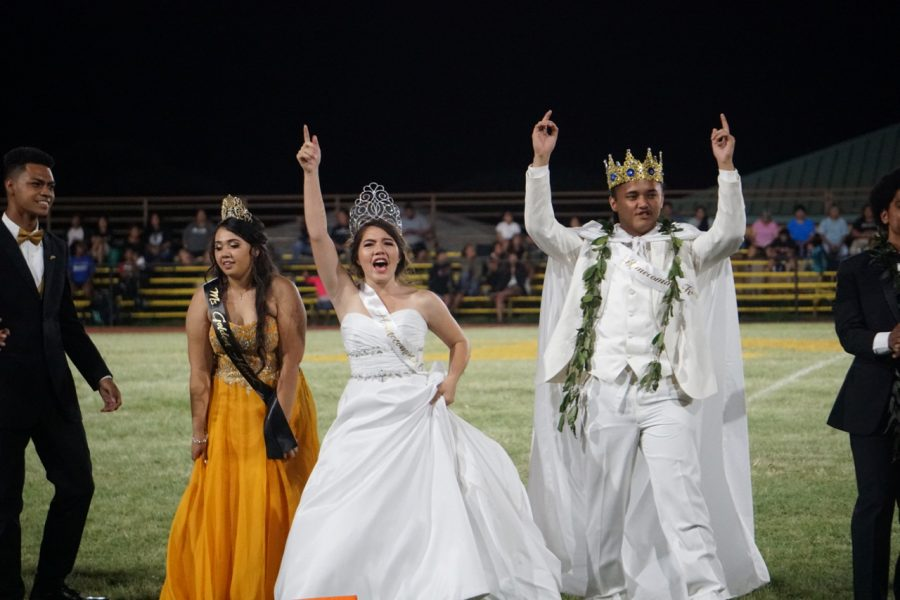 Homecoming Queen, Nalani Schmidt-Sakaba and Homecoming King, Boedy Noa, perform with other court members during halftime.
